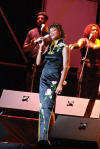 American pop singer Whitney Houston sings during a concert in the Olympic Sports Center in Beijing, capital of China, Sunday, July 25, 2004. The concert, part of Houston's China tour, drew more than 20,000 audience.